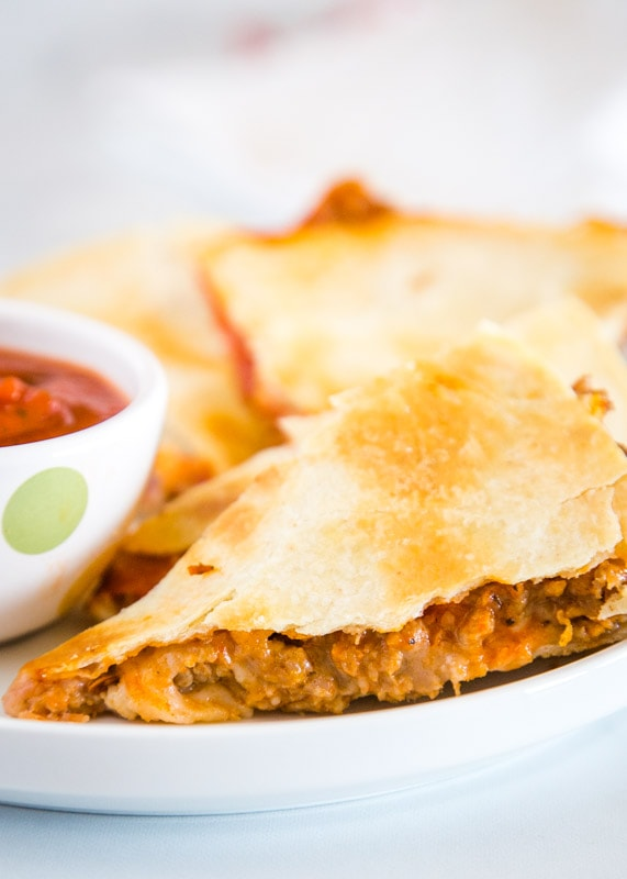 Turn pizza night into a quesadilla! Fill with whatever you love on a pizza and so easy!