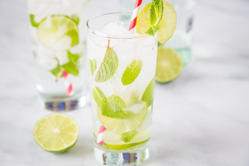The Best Mojito Drink Recipe- A simple and refreshing drink with just 5 simple ingredients; lime juice, white rum, sugar, club soda and mint.  It just might be the perfect rum cocktail!