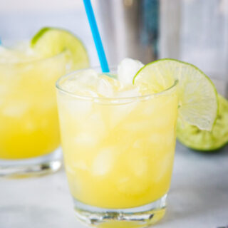 A glass of margarita with slice of lime, with Margarita