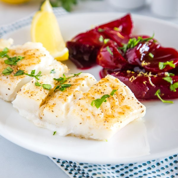 Easy Baked Cod - an easy oven baked cod recipe that is lightly seasoned and topped with melted butter!  Served with Harvard Beets for a delicious meal.
