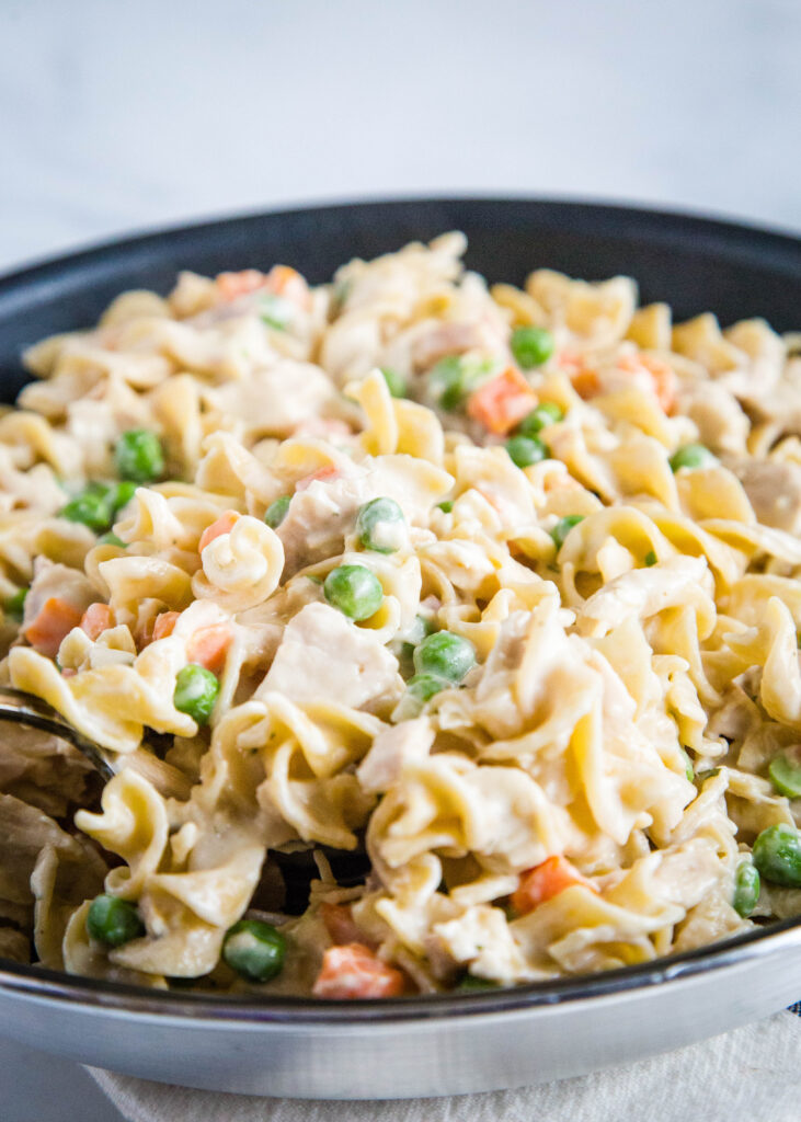 Chicken pot pie pasta is a quick and easy dinner you can make in about 20 minutes any night of the week!