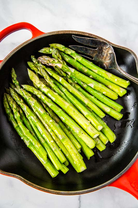 Asparagus is sauteed in butter and olive oil for a delicious and easy side dish