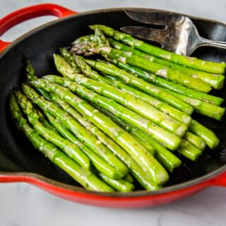Sauteed Asparagus - super simple side dish with asparagus sauteed in butter, garlic and seasoned with salt and pepper.  Ready in just minutes, healthy, and goes with just about everything.