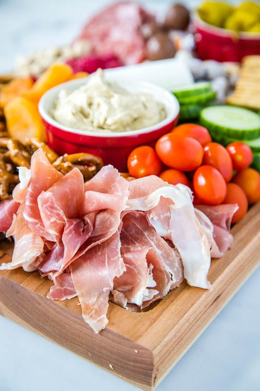 Proscuitto and grape tomatoes on a meat and cheese board