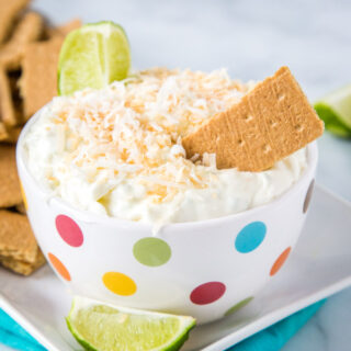 Coconut Lime Cheesecake Dip - a super easy no bake treat that is light, creamy, and absolutely delicious!  Sweet and tart with lots of toasted coconut.  Great with graham crackers or even fruit!