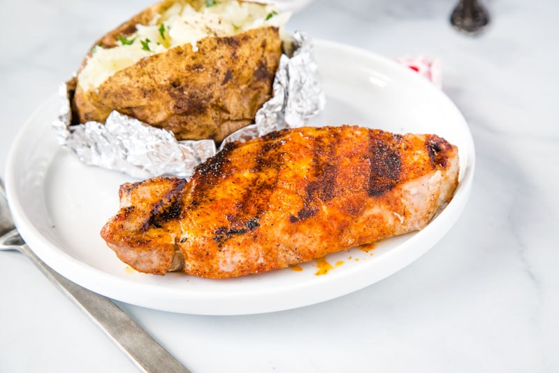 Grilled Pork Chops - super easy pork chops that are seasoned with a few simple spices and then grilled to perfection. Juicy, tender, and the perfect easy summer dinner.