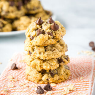 Oatmeal Chocolate Chip Cookies - super soft and chewy oatmeal cookies that are loaded with chocolate chips! A great base to add raisins, nuts, or just about anything else to!