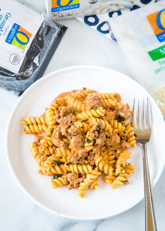 pasta on a plate with package of ground beef, cream cheese and bag of cheese on the side