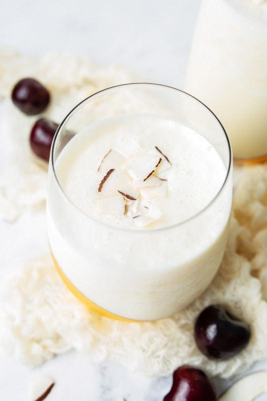 glass in white drink inside