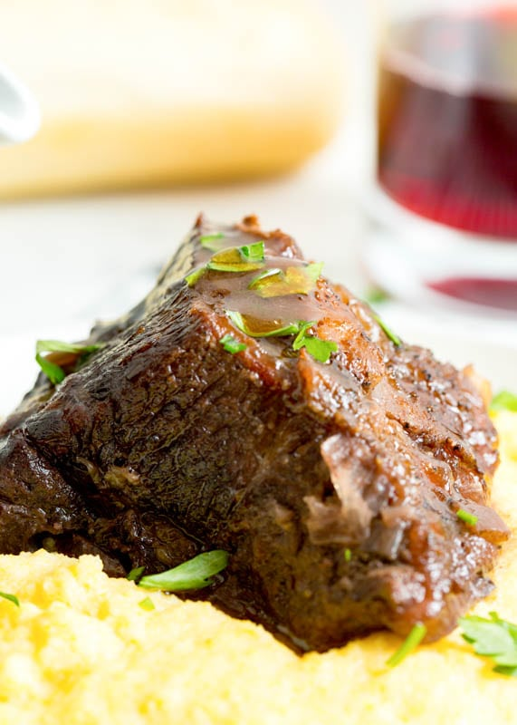 beef short rib with sauce over polenta