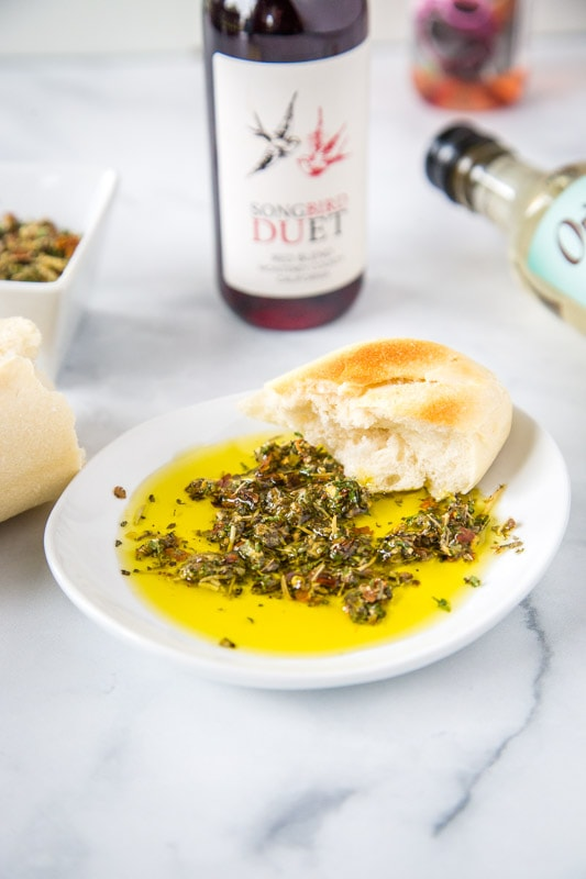 olive oil bread dip in white bowl