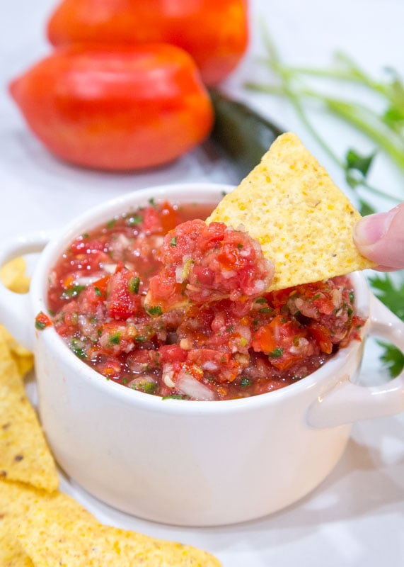 chip dipped in fresh salsa