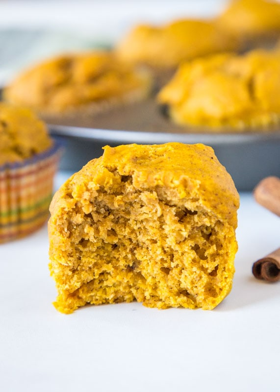 close up pumpkin muffin with bite missing