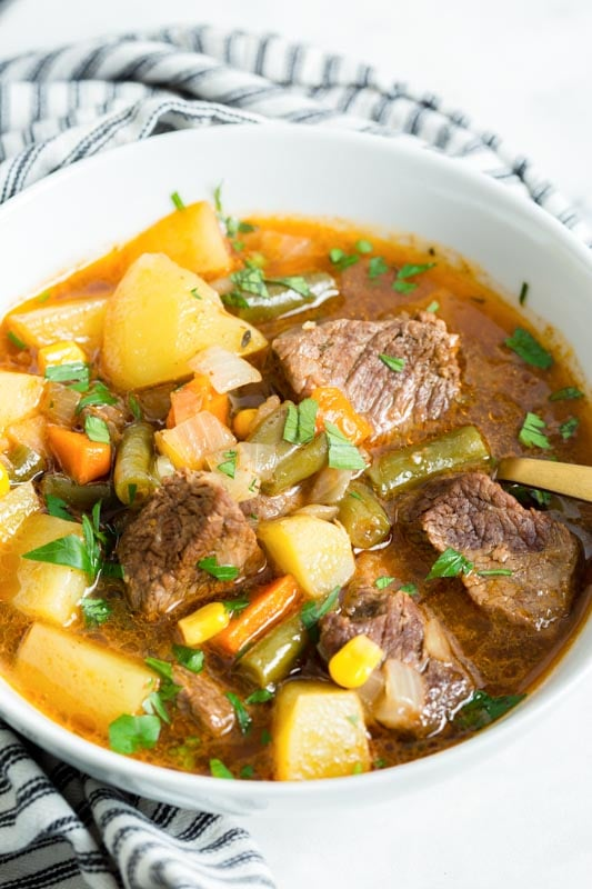 vegetable soup with chunks of beef in a bowl