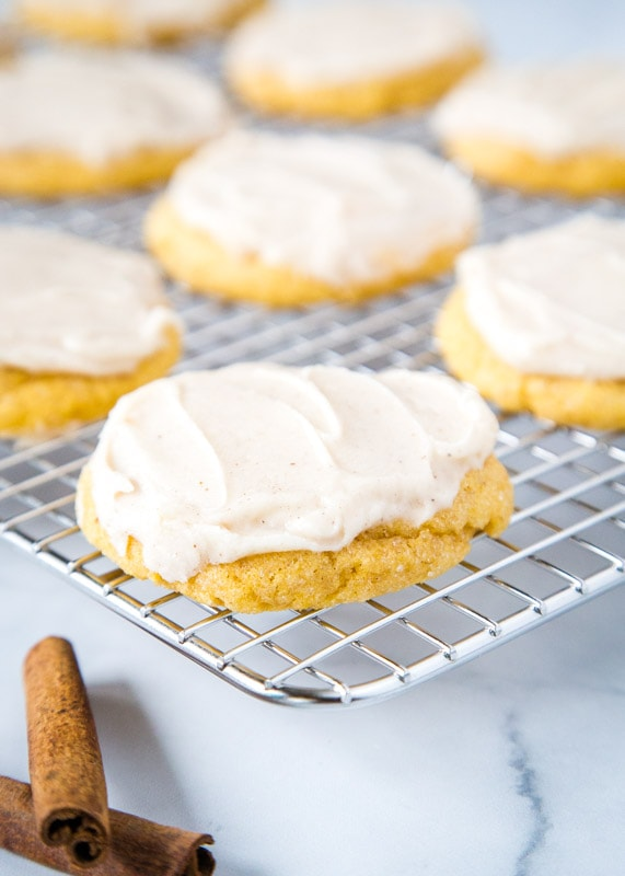 frosted pumpkin sugar cookies on cooling wrack