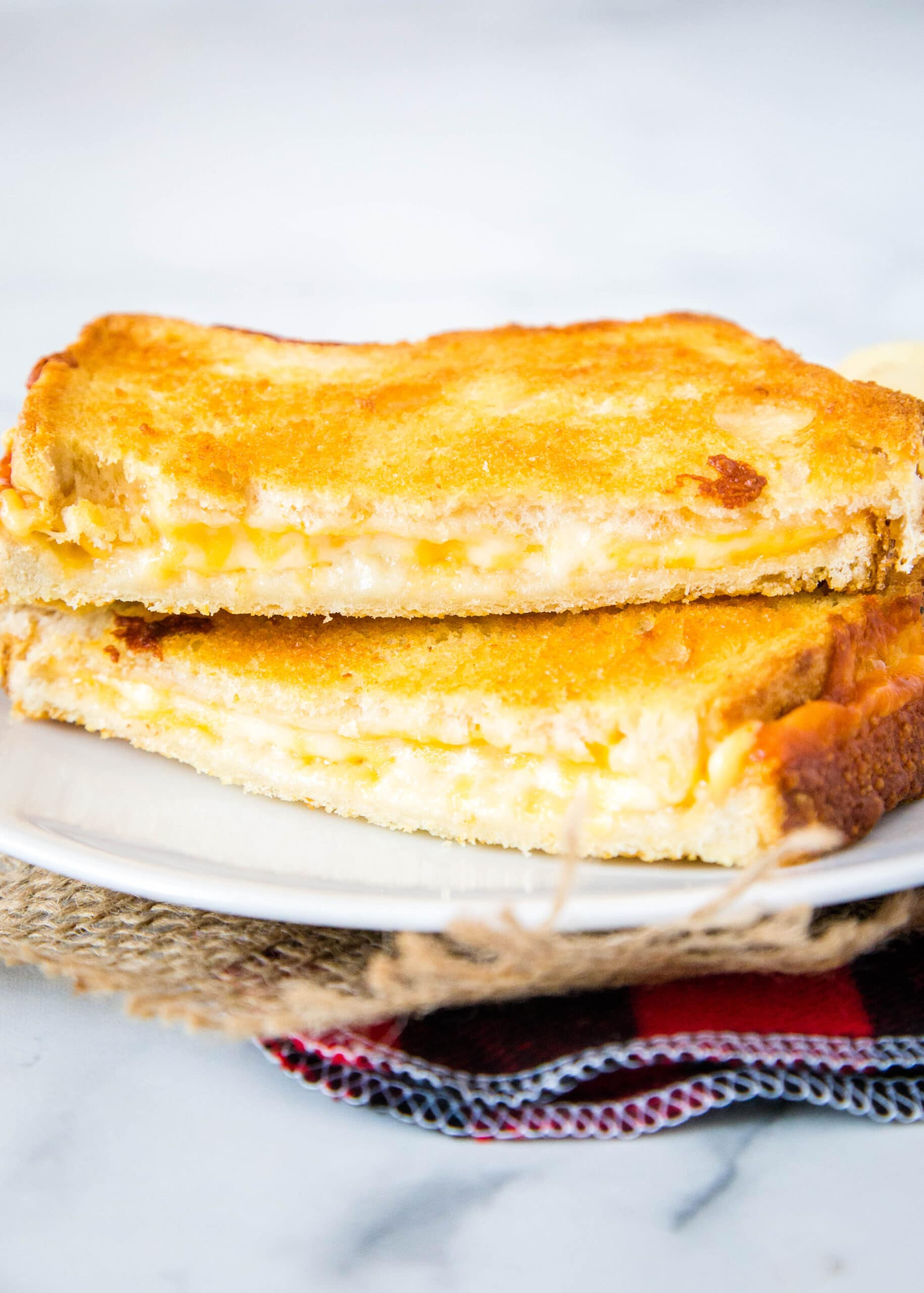 grilled cheese sandwich on a white plate