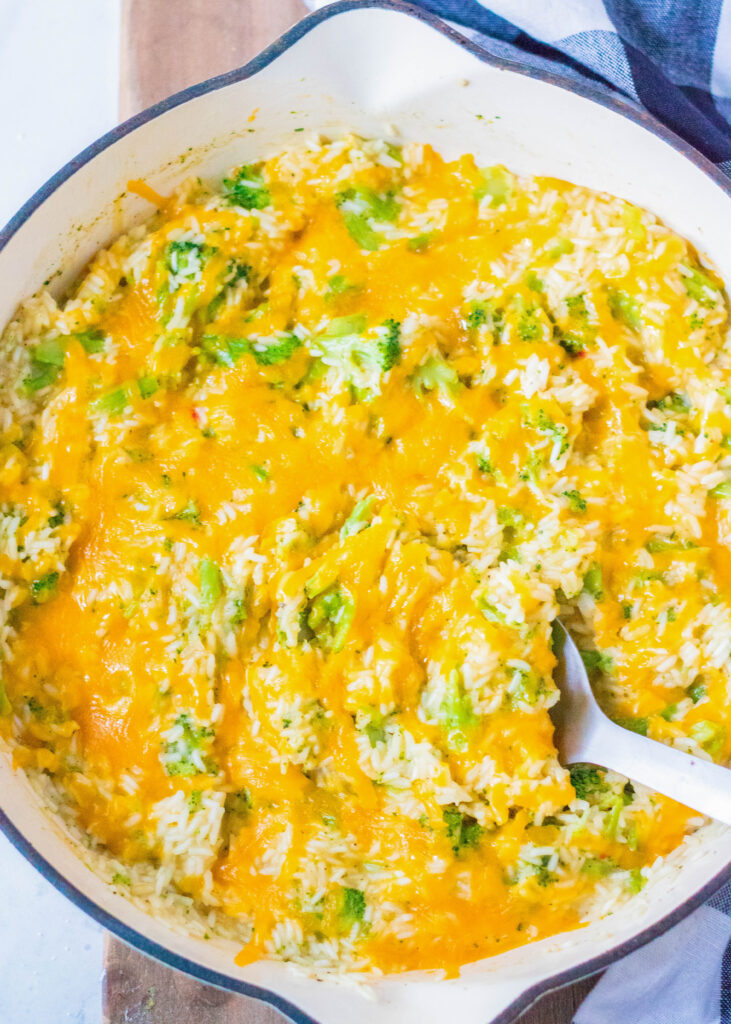 dish of cheesy broccoli rice with spoon