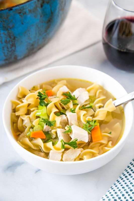 bowl of turkey noodle soup with spoon