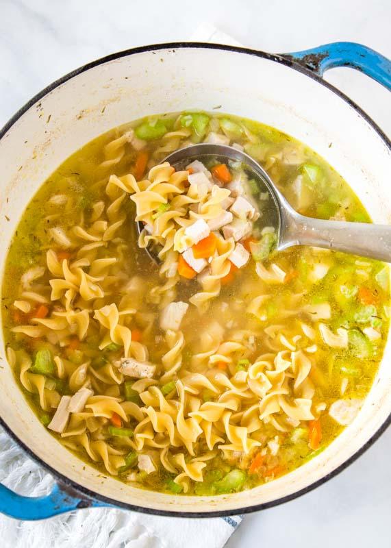 leftover turkey soup in a pot