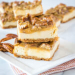 cropped picture of praline bars on white plate