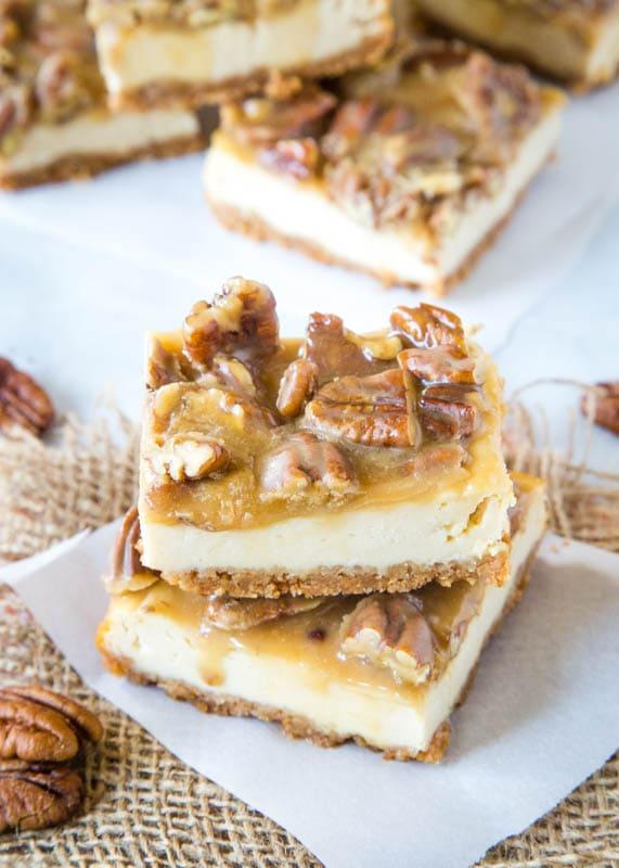 praline cheesecake bars on white paper