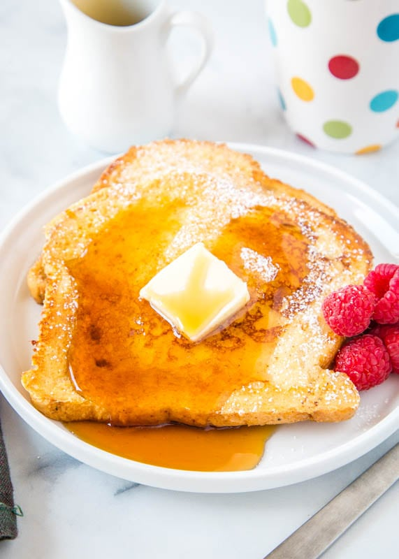 french toast on plate with butter and syrup on top