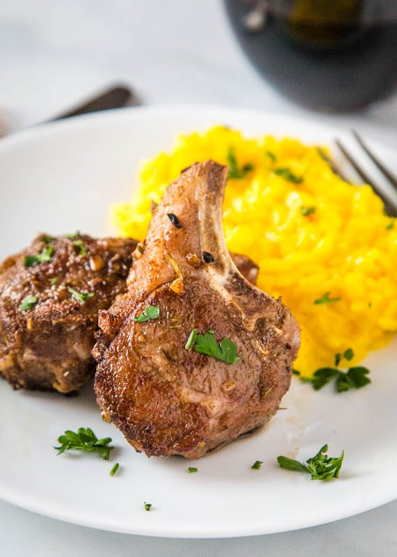 seared lamb chops on plate with risotto