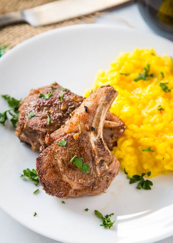 2 lamb chops on plate with risotto