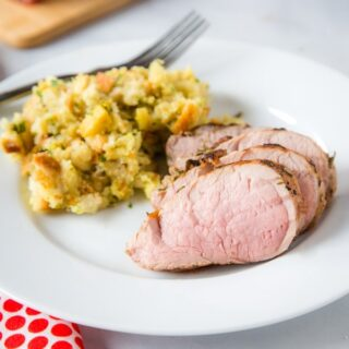 cropped pic of sliced pork tenderloin on plate with stuffing