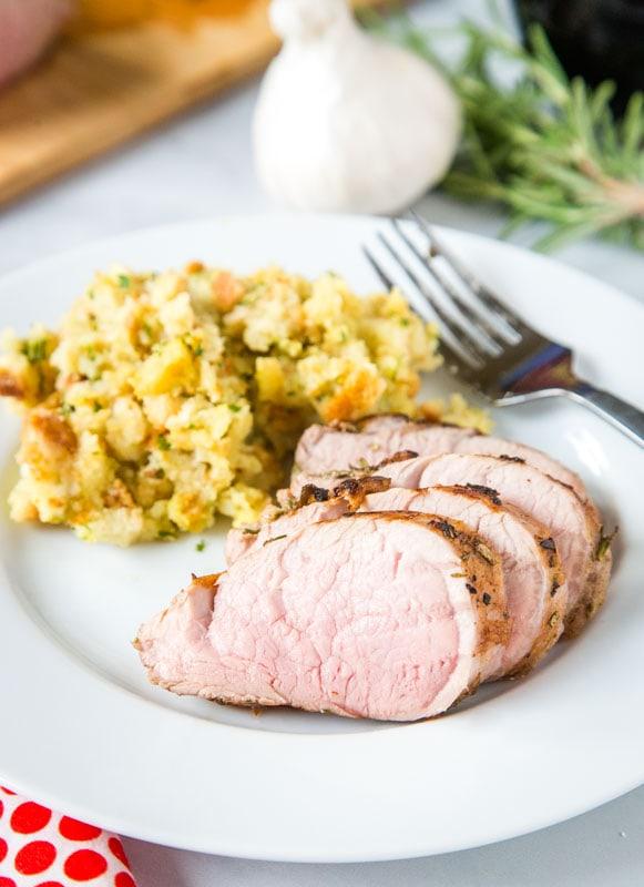 sliced sous vide pork tenderloin on plate with stuffing