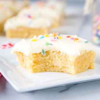 cropped in of sugar cookie bar with bite taken out of it