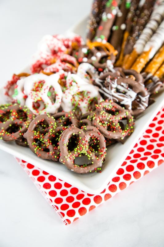 chocolate covered pretzels on white plate`