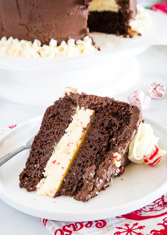 slice of chocolate peppermint cheesecake cake on a white plate