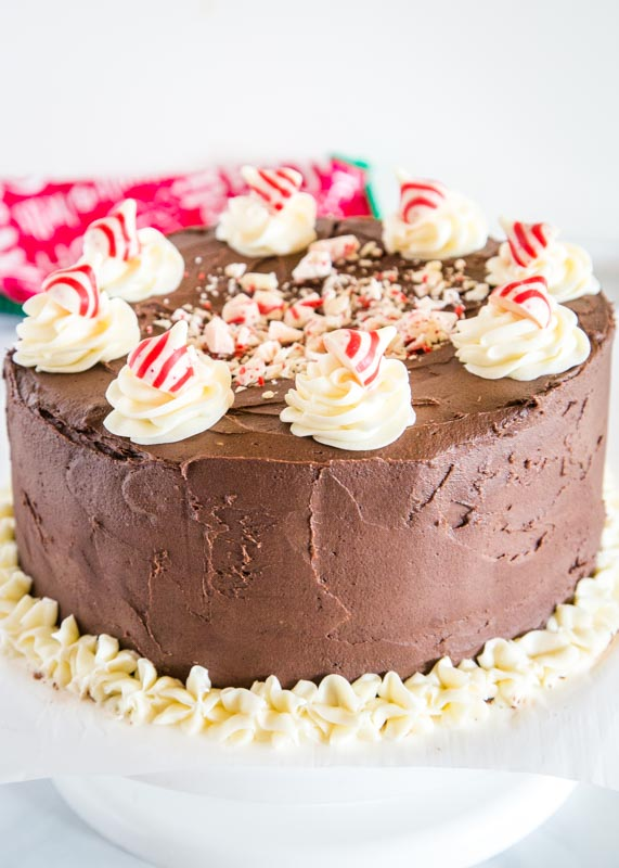 chocolate cake with white frosting and peppermint kisses on top