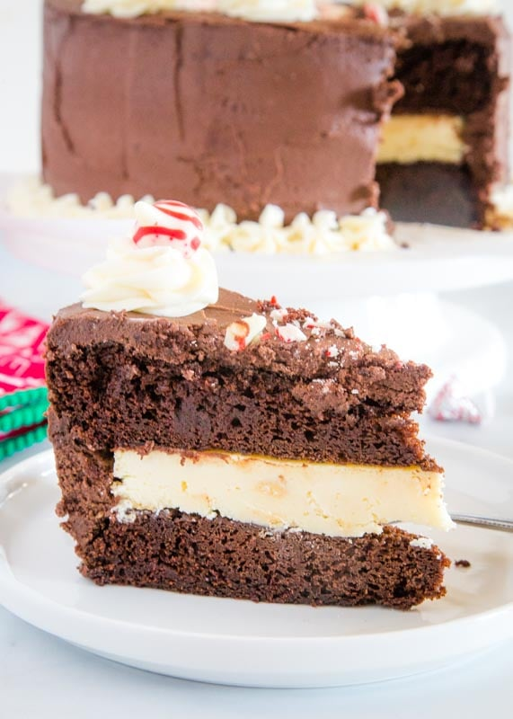 slice of chocolate peppermint cheesecake cake on white plate
