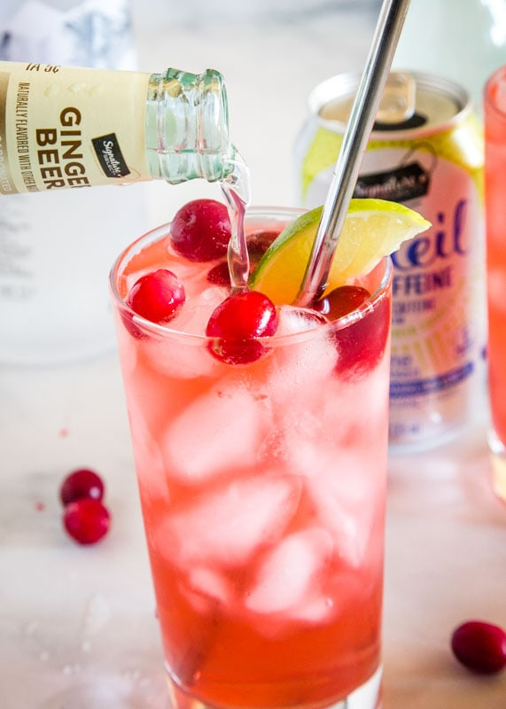 cranberry vodka spritzer with ginger beer being poured in