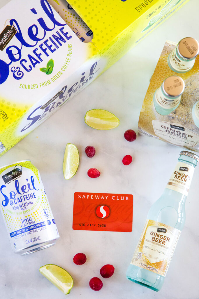 safeway club card with ginger beer, sparkling water, cranberries and lime slices