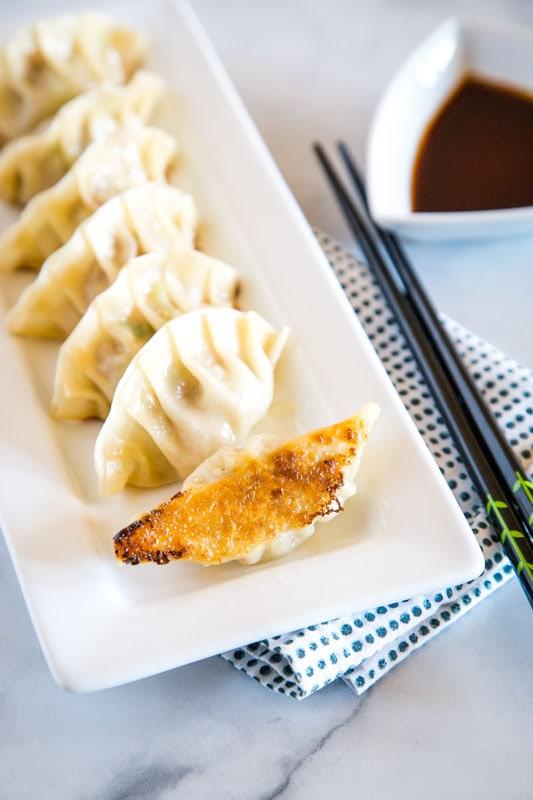 japanese dumplings on white plate