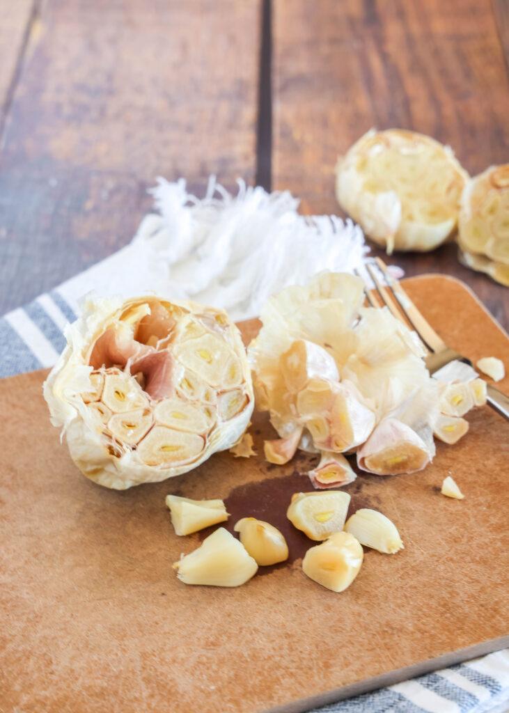 roasted garlic on cutting board