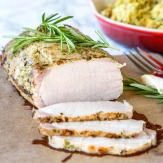 pork loin on cutting board sliced