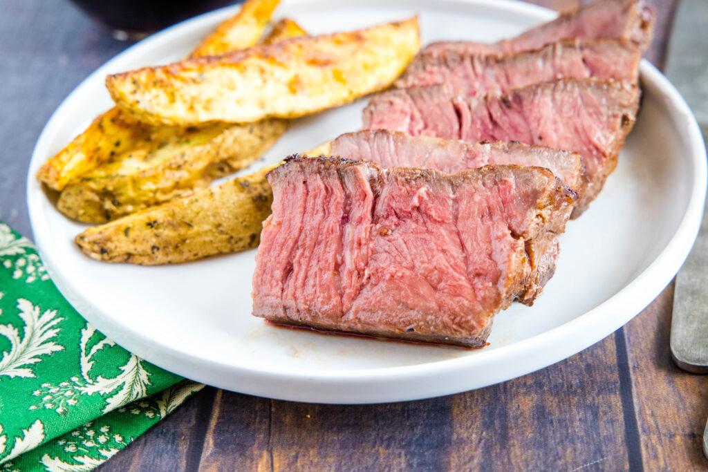 sliced sous vide steak on plate
