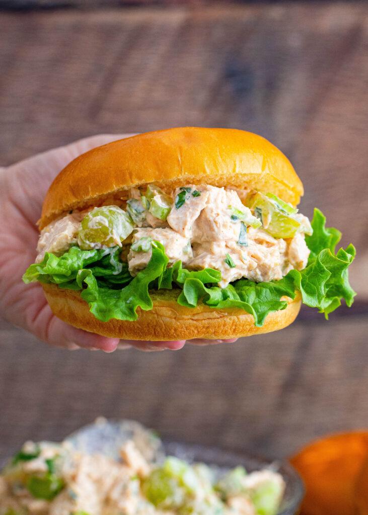 hand holding a chicken salad sandwich