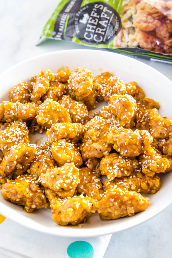 sesame chicken on a white plate
