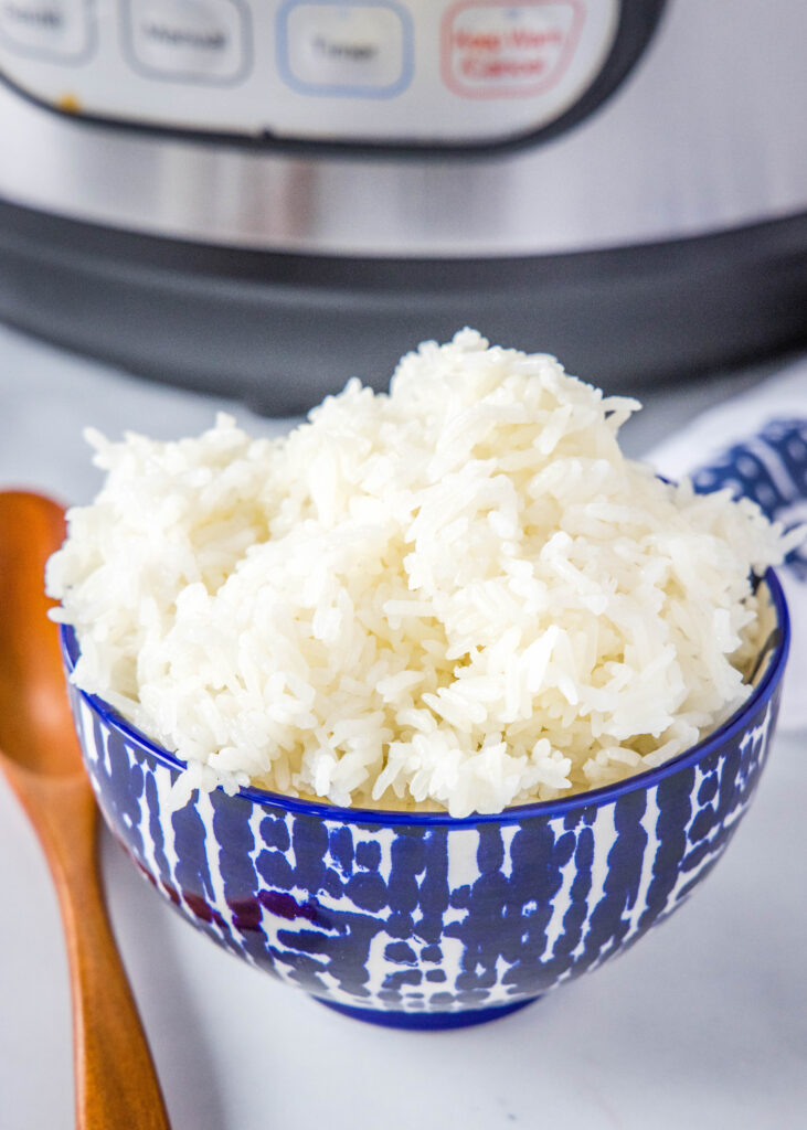 a bowl of white rice with Instant Pot in the background