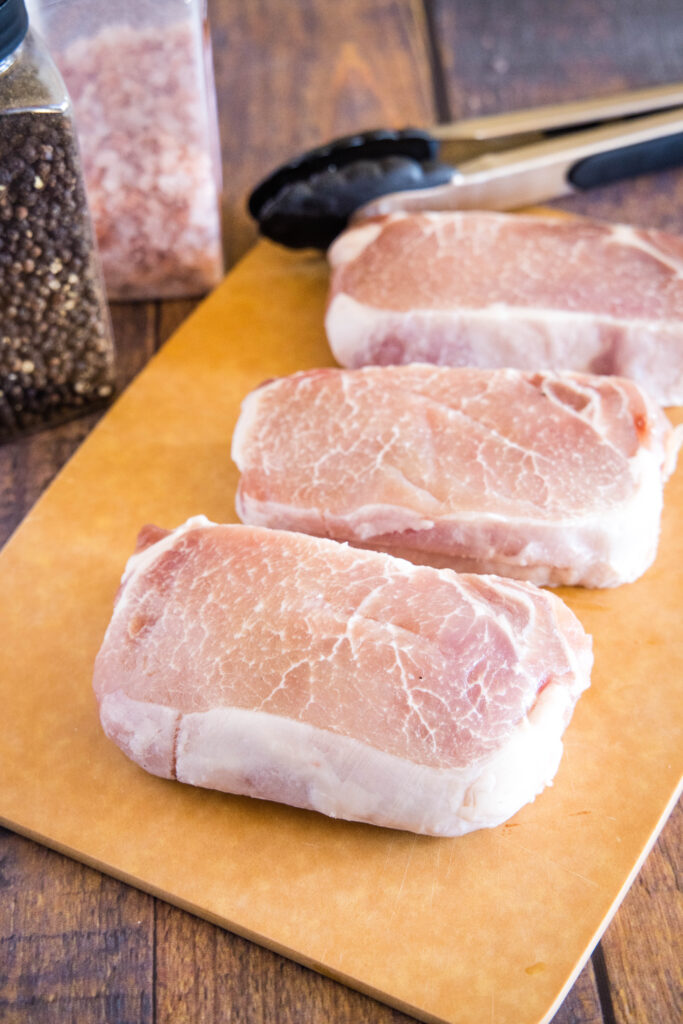 pork chops on cutting board