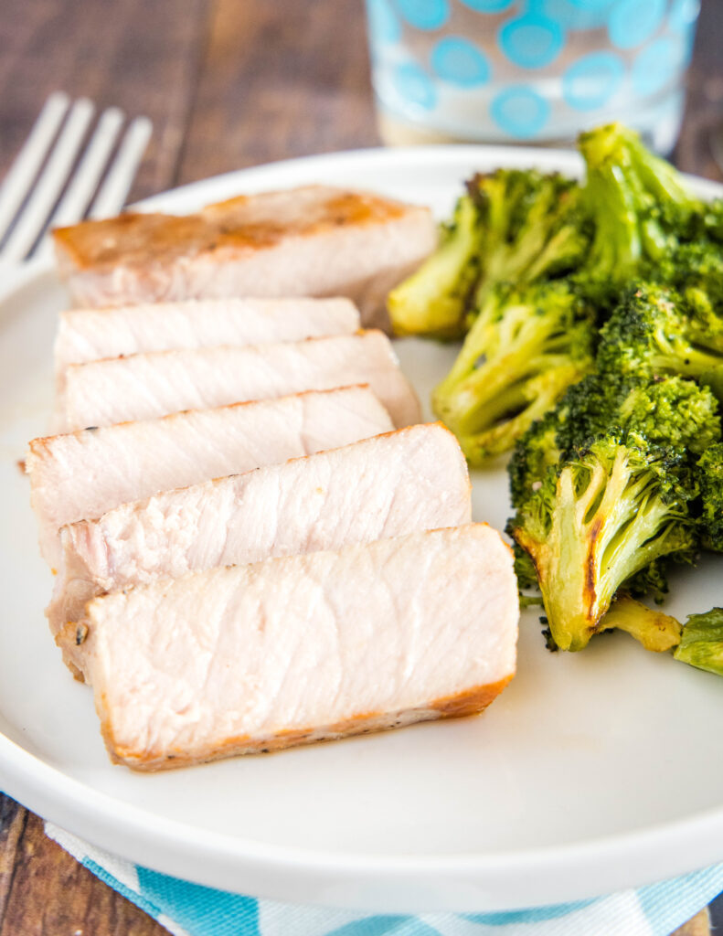 sous vide pork chops on plate with broccoli
