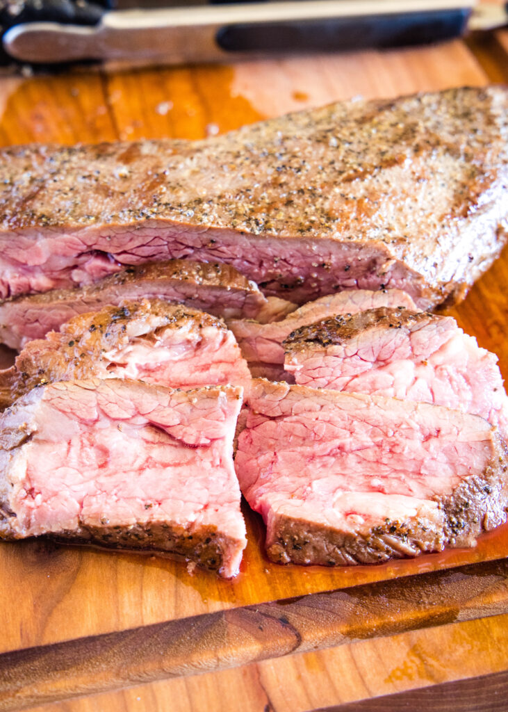 close up of sliced tri tip on cutting board
