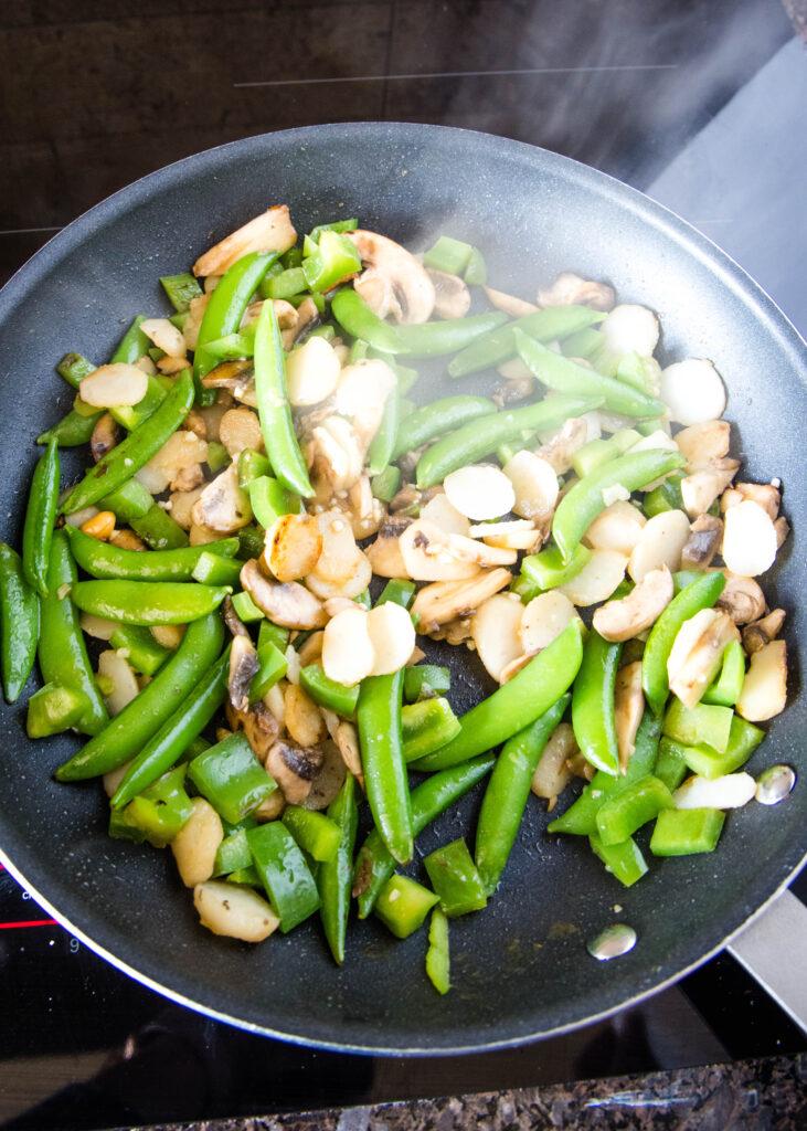 veggies cooking in a skillet