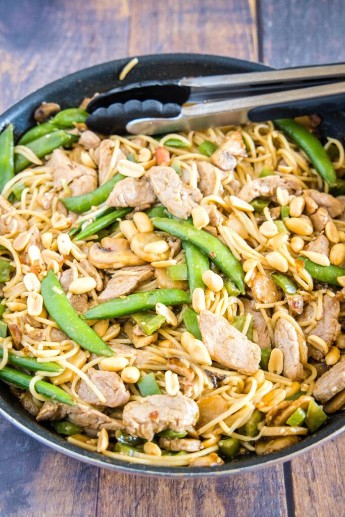asian noodle stir fry in a large skillet