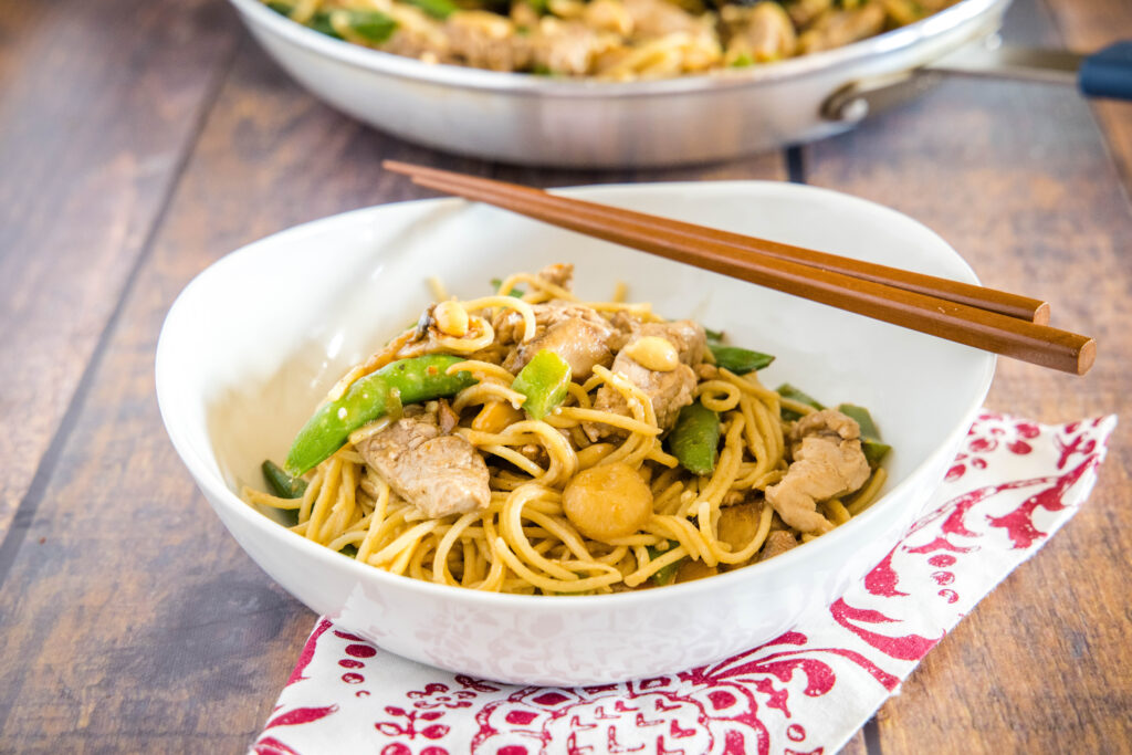 Stir Fry Noodles - Quick and easy Asian Noodles tossed with veggies, your favorite protein (I used pork) and a delicious peanut sauce that has just a little kick.